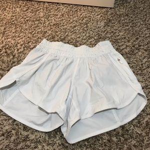 White Lululemon tracker shorts